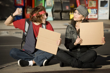Young Man and Woman with Blank Cardboard Signs