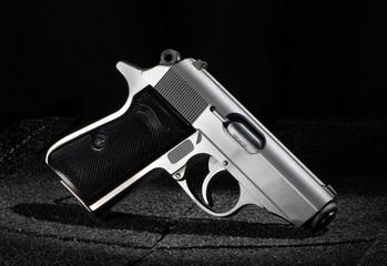 Small Pistol on Black Background