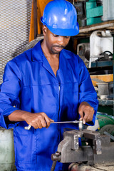 african worker working with spanner