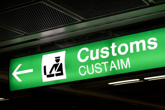 Customs sign in Airport and direction arrow