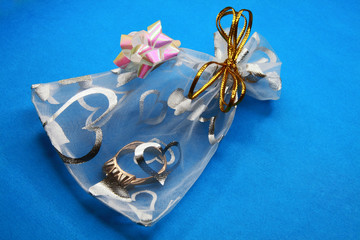 Transparent gift packing with a gold ring inside