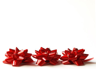 three red gift bows