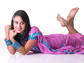 Young girl lying on the floor by lifting her legs
