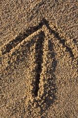 arrow sign in sand