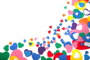 colorful foam confetti hearts over white background