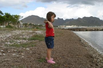 Child throws stone