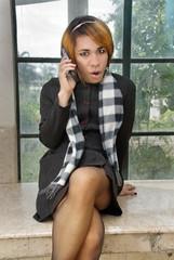 Girl in formal dress calling