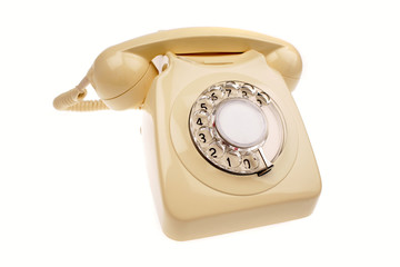 Rotary dial telephone on white
