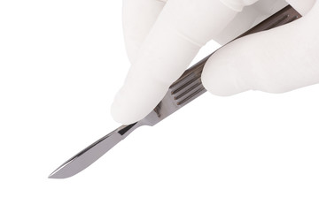 Surgeon hand with a scalpel