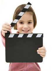 little girl holding a clapperboard isolated on white background