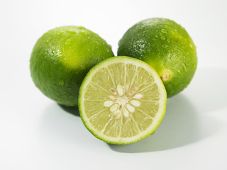 cut of limes  on the white back ground