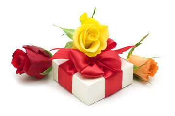 colorful roses and gift box on white background