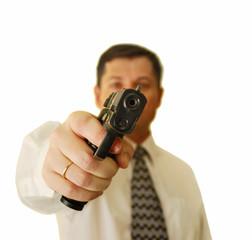The man holds handgun