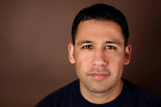 Portrait of a young hispanic man