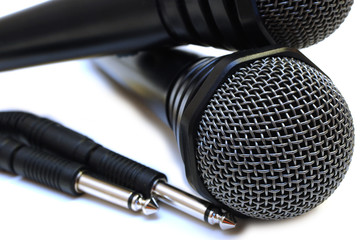 Two black wired karaoke microphones.