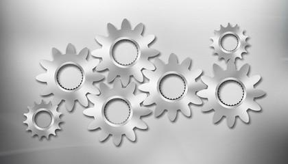 Seven metal gears on metal background