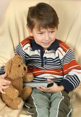 Boy with teddy bear take control