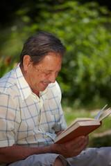 Happy senior man reading