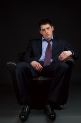 weakness young man in suit