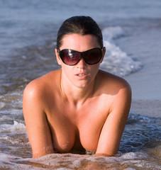 girl resting on the shore