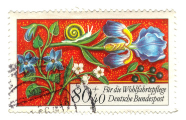Old canceled german stamp with flowers
