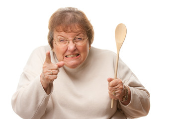 Unhappy Senior Woman with The Wooden Spoon