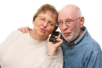 Expressive Senior Couple Using Cell Phone