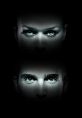 Close up woman and man face in dark background