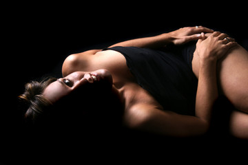 low-key picture of sexy woman lie on floor
