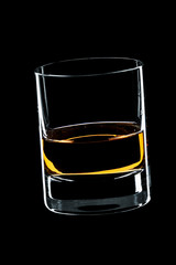 glass of whiskey isolated over black background