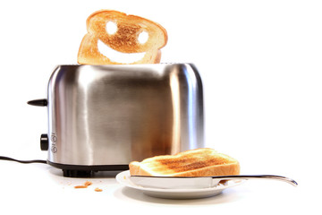 Toasted bread with toaster on white