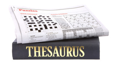 Newspaper crossword on top of a thesaurus