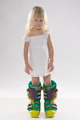 little girl in in big ski boots