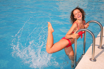 Young woman splashing in basin