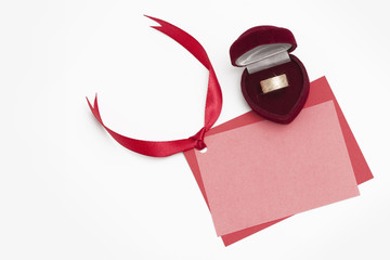 Jewelry Box with ring and pink card on white background