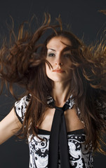 closeup portrait of woman dancing and flipping her hair