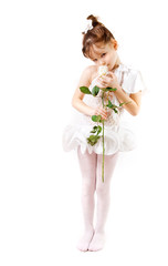 Little girl in white dress with flower on white background