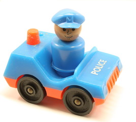 Toy Policeman and Car.