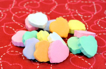 Blank candy hearts stacked.