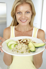 Mid Adult Woman Holding Plate With Healthy Foods