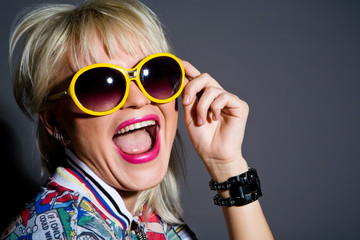 Crazy blond woman in sunglasses