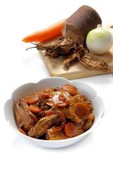 Chiles chipotles curados en salsa de piloncillo