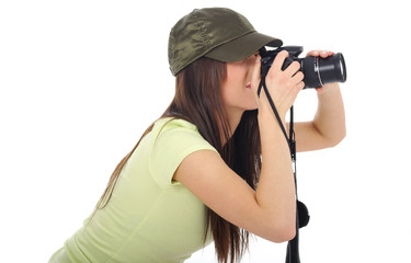 beautiful girl with the camera isolated on a white background