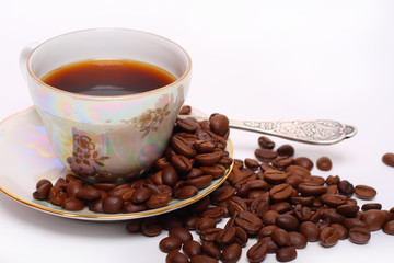 Coffee baens with a cup of coffee