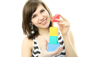 young beautiful woman making a toy house