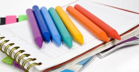 Wax pencils on notebook