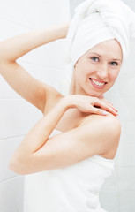 smiley woman with white towel on her head
