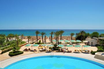 Palm trees, beach, bright sun, yellow sand
