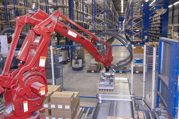 Automatic pallet stacking machine in action