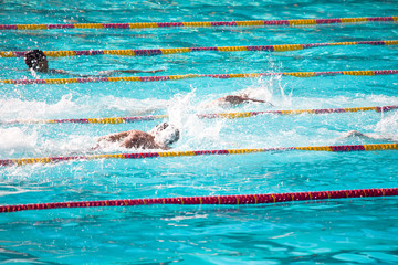 Swimmers Splashing in Competition